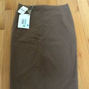 Skirt knee length, runs small